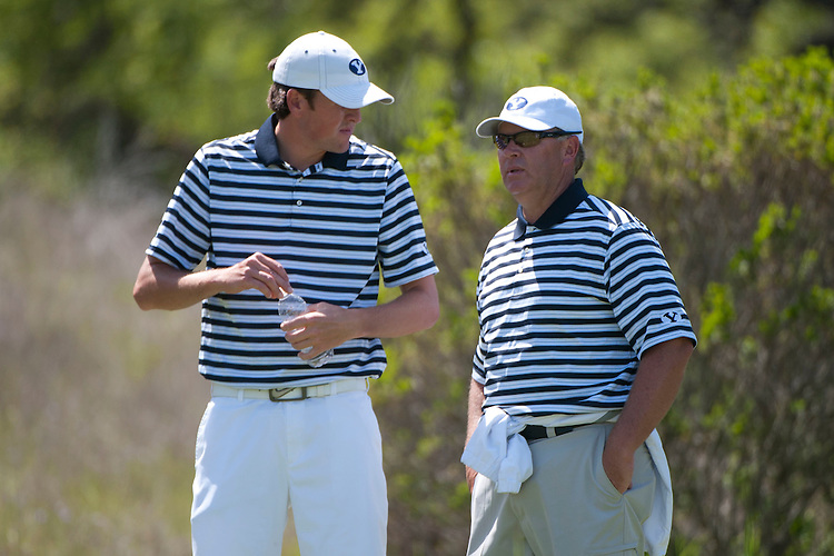 April 18, 2012; Hollister, CA, USA; BYU Cougars golfer Jordan Hammer (left) and men's golf coach Bruce Brockbank (right) during the WCC Golf Championships at San Juan Oaks Golf Club.