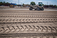 A grinding machine recycles the asphalt and concrete surface of the parking lot of Westerville Square Shopping Center to make way for the construction of a new WalMart store in the Columbus suburb. The store will approximately 108,000-square-feet, about half the  size of a traditional WalMart super store.
