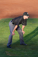 Base umpire Patrick Sharshel in action as the Ogden Raptors faced the Great Falls Voyagers in Pioneer League play at Lindquist Field on August 14, 2013 in Ogden Utah. (Stephen Smith/Four Seam Images)
