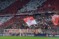 FUSSBALL  CHAMPIONS LEAGUE  HALBFINALE  HINSPIEL  2012/2013      FC Bayern Muenchen - FC Barcelona      23.04.2013 Bayern Fans mit einer Fan Choreographie und einem Banner SCHOENE HEILE WELT