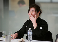NWA Democrat-Gazette/CHARLIE KAIJO Bao Lam Tran of Rogers reacts after tasting a wine and food pairing during a wine tasting class, Monday, November 5, 2018 at Brightwater in Bentonville.<br /><br />Students tested sweet, savory and spicy flavors with a rosŽ, sauvignon blanc and chardaneŽ.<br /><br />&quot;Alcohol is a huge part of the culinary experience. If you go to a restaurant, the majority of the time there is going to be a beverage to pair with the food,&quot; said beverage arts director James King. &quot;When you do a lovely dish, you have to be on your game to know what&Otilde;s the dominant flavor of that dish to work out what&Otilde;s going to be the dominant flavor of the wine to do that pairing.&quot;
