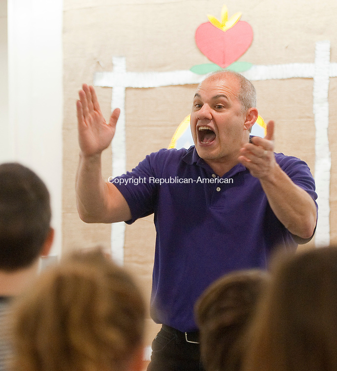 WOODBURY,  CT-122816JS04--Children's entertainer Mr. Joe claps his hands as he sings along with children during his Sing, Laugh, and Learn with Mr. Joe program Wednesday at the Woodbury Public Library. The program was made possible through the Friends of the Woodbury Library. <br /> Jim Shannon Republican-American