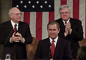 United States President George W. Bush delivers his address to a Joint Session of the 107th Congress Tuesday Feb. 27, 2001 at the Capitol in Washington. Bush outlined his tax cut proposal and other budget issues for the year.  U.S. Vice President Dick Cheney, left, and U.S. House Speaker Dennis Hastert (Republican of Illinois), right look on. <br /> Credit: Doug Mills / Pool via CNP