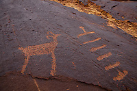 Petroglyphs at the entrance to Three Fingers Canyon, in Utah's San Rafael Reef.<br /> <br /> Petroglyphs (also called rock engravings) are images created by removing part of a rock surface by incising, pecking, carving, and abrading.