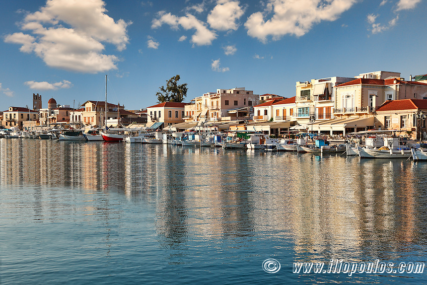 Boats and traditional houses in the port of Aegina island, Greece