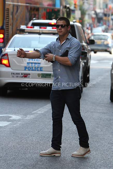WWW.ACEPIXS.COM . . . . .  ....July 8 2012, New York City....Musician Nick Jonas hails a cab outside his Chelsea apartment on July 8 2012 in New York City....Please byline: Zelig Shaul - ACE PICTURES.... *** ***..Ace Pictures, Inc:  ..Philip Vaughan (212) 243-8787 or (646) 769 0430..e-mail: info@acepixs.com..web: http://www.acepixs.com