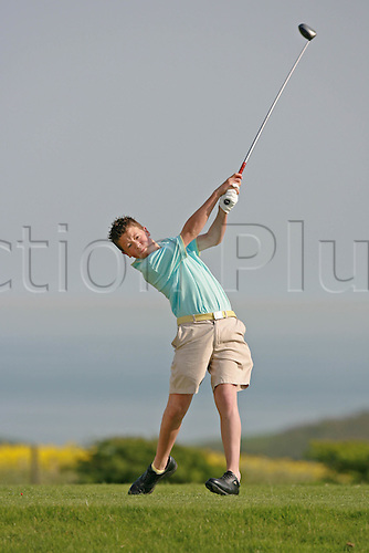 Model Released Image. A teenage golfer plays a tee shot at East Brighton Golf Club, Brighton, East Sussex, England. Photo: Steve Bardens/actionplus...golf club children child boy teenager male recreation leisure youth playing tees swing