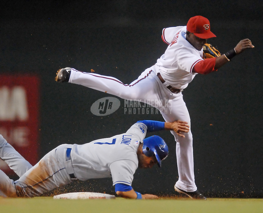 Jun 27, 2007; Phoenix, AZ, USA; Arizona Diamondbacks scond baseman (1) Orlando Hudson throws to first to complete the double play after forcing out Los Angeles Dodgers infielder (7) James Loney in the fourth inning at Chase Field. Mandatory Credit: Mark J. Rebilas