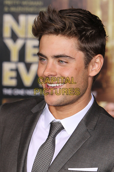 "Zac Efron.The World Premiere of ""New Year's Eve' held at The Grauman's Chinese Theatre in Hollywood, California, USA..December 5th, 2011.headshot portrait white shirt grey gray tie stubble facial hair .CAP/CEL .©CelPh/Capital Pictures."