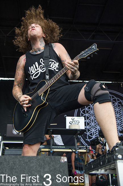 Lee Malia of BRING ME THE HORIZON performs during the Vans Warped Tour at the Klipsch Music Center in Indianapolis, IN.