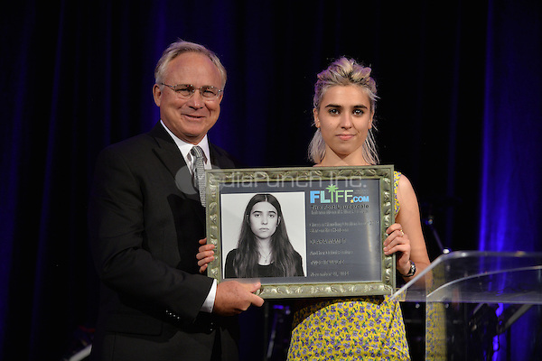HOLLYWOOD, FL - NOVEMBER 21: Clara Mamet (L) and Guest attends Fort Lauderdale International Film Festival 2014 Chairman's Award Gala and received The star On The Horizon Award at Westin Diplomat Resort and Spa on November 21, 2014 in Boca Raton, Florida. Credit: MPI10 / MediaPunch