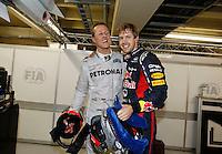 ATENCAO EDITOR: FOTO EMBARGADA PARA VEICULO INTERNACIONAL - SAO PAULO, SP 25 DE NOVEMBRO 2012 - FORMULA 1 GP BRASIL - O piloto alemao Sebastian Vettel e o compatriota Michael Schumacher da equipe Mercedes GP comemora a conquista do tri campeonato durante o Grande Premio do Brasil de Formula 1, no autodromo de Interlagos, zona sul da capital, neste domingo.FOTO: PIXATHLON - BRAZIL PHOTO PRESS