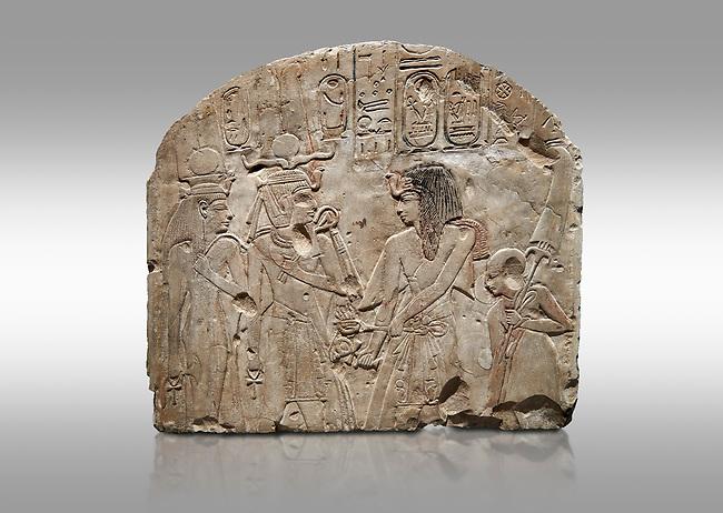 Ancient Egyptian stele depicting Sethy I adoring Amenhotep I and Nefertari, limestone, New Kingdom, 19th Dynasty, (1279-1213 BC), Deir el-Medina,  Egyptian Museum, Turin. Grey background. Schiaparelli Cat 6189.