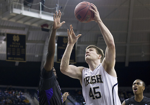 December 21, 2012:  Notre Dame forward Jack Cooley (45) goes up for a shot during NCAA Basketball game action between the Notre Dame Fighting Irish and the Niagara Purple Eagles at Purcell Pavilion at the Joyce Center in South Bend, Indiana.  Notre Dame defeated Niagara 89-67.