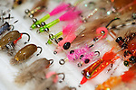 Saltwater fishing flies displayed on a ripple foam board