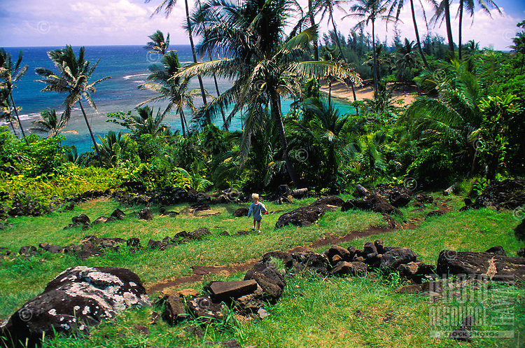 Kee beach with Ka ulu paoa heiau, on the north shore of Kauai. Ka ulu paoa is the place where Pele, Lohiau and Paoa practiced hula in Hawaiian history. A shrine to Laka, the goddess of hula, is located in a cleft in the hillside behind the platform.