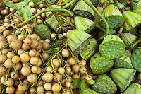 Yellow Grape and Lotus (Nelumbo nucifera) fruits for sale at a food market in Yangshuo, Guangxi, China.