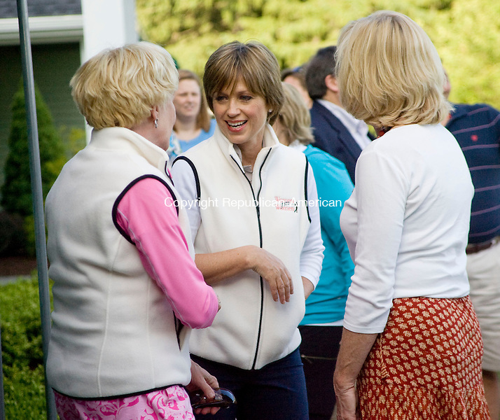 WATERBURY, CT - 07 JUNE 2010 -060710JT17-<br /> Dorothy Hamill, the 1976 Olympic figure skating champion, chats with Chris Geraghty and Mary Wiatr during an evening reception in support of the Mammography Fund at Saint Mary's Hospital on Monday at the Waterbury Country Club. The reception, hosted by the Saint Mary's Hospital Foundation, followed the 3rd annual Dorothy Hamill Women Fore Women Golf Tournament, of which Geraghty and Wiatr were co-chairs. The Mammography Fund provides free mammograms to hundreds of area women who would otherwise not have access to them. <br /> Josalee Thrift Republican-American