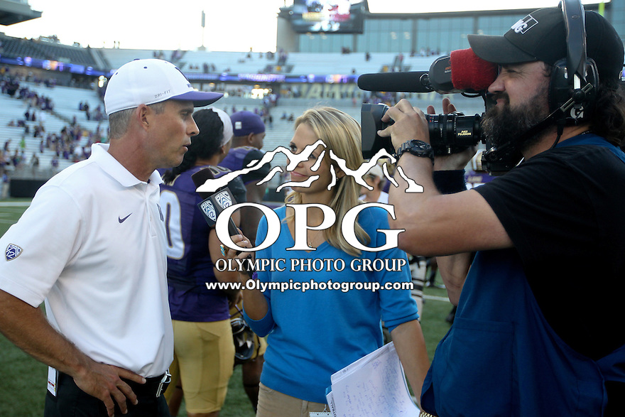 Sept 20, 2014:  Washington head coach Chris Petersen does an interview after the game against Georgia State.  Washington defeated Georgia State 45-14 at Husky Stadium in Seattle, WA.