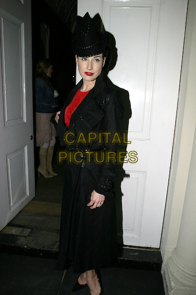 DITA VON TEESE.Attends intimate dinner at Sketch, to launch The One & Only Reethi Rah, an exclusive island resort in the Maldives, Sketch, Conduit Street, London, .April 19th 2005..full length black hat red lipstick   coat top .Ref: AH.www.capitalpictures.com.sales@capitalpictures.com.?Adam Houghton/Capital Pictures.