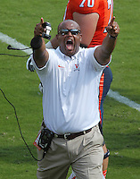 Virginia head coach Mike London reacts to a touchdown by saluting the fans during the football game Saturday Oct. 5, 2013 at Scott Stadium in Charlottesville, VA. Ball State defeated Virginia 48-27. Photo/The Daily Progress/Andrew Shurtleff