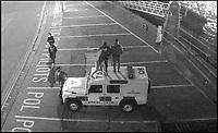 Brazen vandals trash police car.