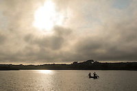 Kayakers on a pond next to the Chilmark town beach of Lucy Vincent, on Martha's Vineyard... ..................