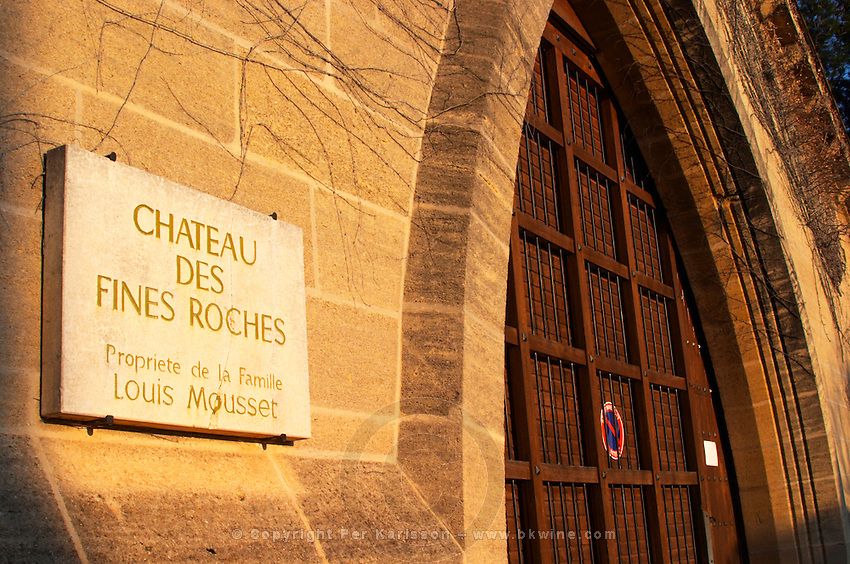 A big wooden door and sign for the Chateau des Fines Roches, property of the Louis Mousset family, Chateauneuf-du-Pape, Vaucluse, Rhone, Provence, France