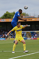 Paul Kalambayi of AFC Wimbledon wins the ball from David Wheeler of Wycombe Wanderers during AFC Wimbledon vs Wycombe Wanderers, Sky Bet EFL League 1 Football at the Cherry Red Records Stadium on 31st August 2019