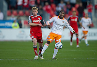 07 May2011: Houston Dynamo midfielder Lovel Palmer #22 and Toronto FC midfielder Jacob Peterson #23 in action during an MLS game between the Houston Dynamo and the Toronto FC at BMO Field in Toronto, Ontario.