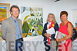 Syra Larkin Maherees centre explains her Oil on linen painting The Gathering of Memories to her husband Chris and artist Julie Beckett Ballyferriter at The Gathering Art an exhibition of work by Kerry Artists  in the Department of Arts, Tourism and the Gaelteacht on Monday evening