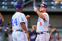 Chattanooga Lookouts outfielder Scott Schebler (8) fist bumps manager Razor Shines (44) during introductions before game three of the Southern League Championship Series against the Jacksonville Suns on September 12, 2014 at Bragan Field in Jacksonville, Florida.  Jacksonville defeated Chattanooga 6-1 to sweep three games to none.  (Mike Janes/Four Seam Images)