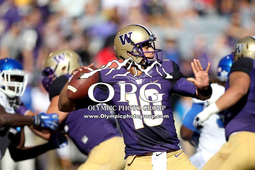 Sept 20, 2014:  Washington quarterback #10 Cyler Miles fires the ball down field against Georgia State.  Washington defeated Georgia State 45-14 at Husky Stadium in Seattle, WA.