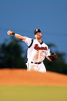 Nashville Sounds third baseman Taylor Green (3) throws to first during a game against the Omaha Storm Chasers on May 19, 2014 at Herschel Greer Stadium in Nashville, Tennessee.  Nashville defeated Omaha 5-4.  (Mike Janes/Four Seam Images)