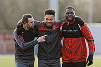 Pictured: (L-R) Paul Hayes, Jazzi Barnum-Bobb and Frank Nouble embrace during training. Thursday 18 January 2018<br /> Re: Players and staff of Newport County Football Club prepare at Newport Stadium, for their FA Cup game against Tottenham Hotspur in Wales, UK