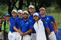 Members of the Team Europe on the 18th fairway supporting Bernd Wiesberger and Rafa Cabrera Bello during the Friday Foursomes of the Eurasia Cup at Glenmarie Golf and Country Club on the 12th January 2018.<br /> Picture:  Thos Caffrey / www.golffile.ie