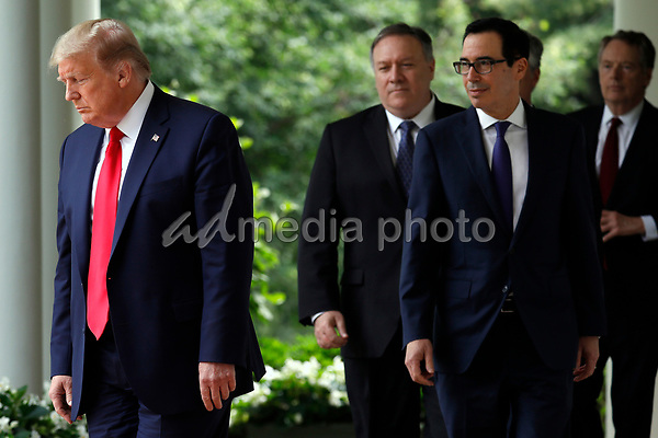 United States President Donald J. Trump arrives to deliver remarks on China in the Rose Garden at the White House in Washington, DC on May 29, 2020.  Pictured from left to right: the president; US Secretary of State Mike Pompeo; US Secretary of the Treasury Steven T. Mnuchin and Ambassador Robert Lighthizer, United States Trade Representative.<br /> Credit: Yuri Gripas / Pool via CNP/AdMedia