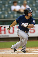 New Orleans Zephyrs third baseman Zach Cox (22) follows through on his swing during the Pacific Coast League baseball game against the Round Rock Express on May 27, 2014 at the Dell Diamond in Round Rock, Texas. The Zephyrs defeated the Express 9-0 in a rain shortened game. (Andrew Woolley/Four Seam Images)