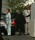 Bill Cosby departs the White House after receiving the Presidential Madal of Freedom from U.S. President George W. Bush during a ceremony in the East Room of the White House in Washington, D.C. on July 9, 2002..Credit: Ron Sachs / CNP