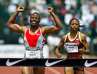 Kelli Whitewins the womens 200mm dash during the 2003 United States Track & Field Championships held at Cobb Track & Angell Field, Palo Alto, CA<br />