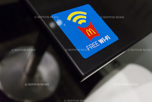 Free wi-fi access promoted inside McDonald's Azabujuban branch on June 23, 2016, Tokyo, Japan. McDonald's Japan launched the service on June 20th and announced that it will provide free wi-fi in some 1,500 branches across Japan by the end of July. (Photo by Rodrigo Reyes Marin/AFLO)