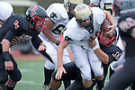 Palos Verdes, CA 11/10/11 - Tommy Webster (Peninsula #49) and unidentified Palos Verdes player(s) in action during the Peninsula-Palos Verdes varsity football game.