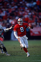 SAN FRANCISCO, CA:  Quarterback Steve Young of the San Francisco 49ers runs with the football during the NFC Championship game against the Dallas Cowboys at Candlestick Park in San Francisco, California on January 15, 1995. (Photo by Brad Mangin)