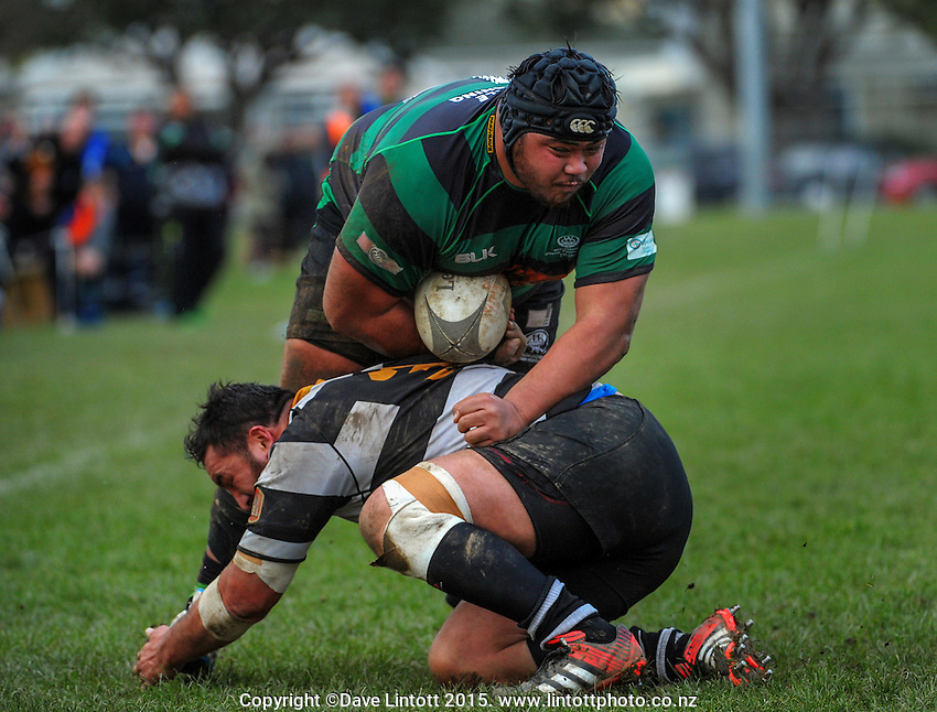 Orie's prop Whetu Henry tackles his Wainui opposite Attila Va'a during the Wellington Club Rugby Jubilee Cup match between Oriental-Rongotai (black and white) and Wainuiomata (green and black) at the Polo Ground, Wellington, New Zealand on Saturday, 4 April 2015. Photo: Dave Lintott / lintottphoto.co.nz