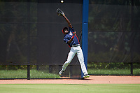 GCL Nationals left fielder Eric Senior (26) jumps to try to make a catch during a game against the GCL Astros on August 6, 2018 at FITTEAM Ballpark of the Palm Beaches in West Palm Beach, Florida.  GCL Astros defeated GCL Nationals 3-0.  (Mike Janes/Four Seam Images)