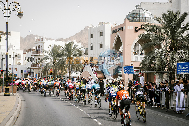 The peloton lined out during Stage 6 of the 10th Tour of Oman 2019, running 135.5km from Al Mouj Muscat to Matrah Corniche, Oman. 21st February 2019.<br /> Picture: ASO/P. Ballet | Cyclefile<br /> All photos usage must carry mandatory copyright credit (© Cyclefile | ASO/P. Ballet)