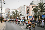 The peloton lined out during Stage 6 of the 10th Tour of Oman 2019, running 135.5km from Al Mouj Muscat to Matrah Corniche, Oman. 21st February 2019.<br /> Picture: ASO/P. Ballet | Cyclefile<br /> All photos usage must carry mandatory copyright credit (&copy; Cyclefile | ASO/P. Ballet)