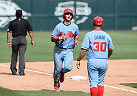 NWA Democrat-Gazette/CHARLIE KAIJO Ole Miss scores during game two of the College Baseball Super Regional, Sunday, June 9, 2019 at Baum-Walker Stadium in Fayetteville. Ole Miss forces a game three with a 13-5 win over the Razorbacks