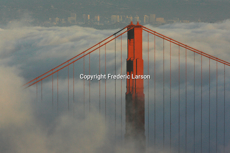 The fog roll under the Golden Gate Bridge engulfing the  San Francisco Bay.