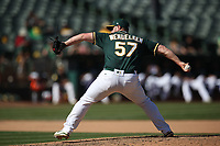 OAKLAND, CA - SEPTEMBER 20:  J.B. Wendelken #57 of the Oakland Athletics pitches against the Los Angeles Angels of Anaheim during the game at the Oakland Coliseum on Thursday, September 20, 2018 in Oakland, California. (Photo by Brad Mangin)